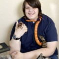 DESBOROUGH, UNITED KINGDOM, APRIL 24, 2013: Liam Andrews  holding his pets corn snake, tarantula and hognose snake at home in Desborough, Northamptonshire. See NTI story NTIWILD.  A teenage boy has told how his obsession with animals has spiralled so much out of control he now shares a house -  with over 300 PETS.  Animal-mad Liam Andrews, 16, sleeps next to a hair-raising collection of creepie-crawlies in his bedroom  - including 12 tarantulas, eight snakes and five scorpions.   He also owns an exotic array of lizards, frogs and birds which all cram into his family's modest three-bedroomed semi-detached home.  As well as sharing a bedroom with over 60 cold-blooded reptiles, Liam even watches TV with his snakes and takes them down the shops.  He spends two hours a day feeding his beloved pets and reckons he has been bitten or stung by them at least 200 times.