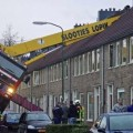 Crane crashes into house in Netherlands